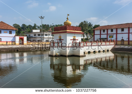 stock-photo-madikeri-india-october-shree-omkareshwara-temple-white-golden-and-marron-shrine-set-1037227756