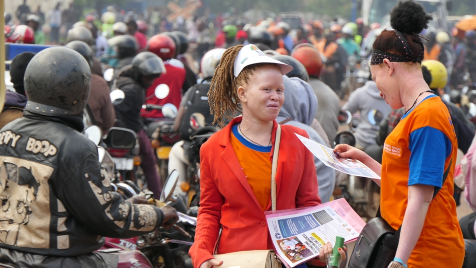 Creating awareness on albinism through distribution of flyers with facts on albinism in the streets of kamapala