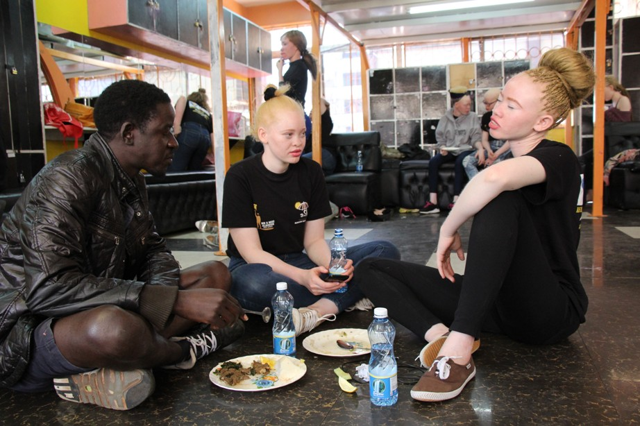 Pat Marryaan reigning miss Albinism East Africer in the centre and Shalen haing lunch