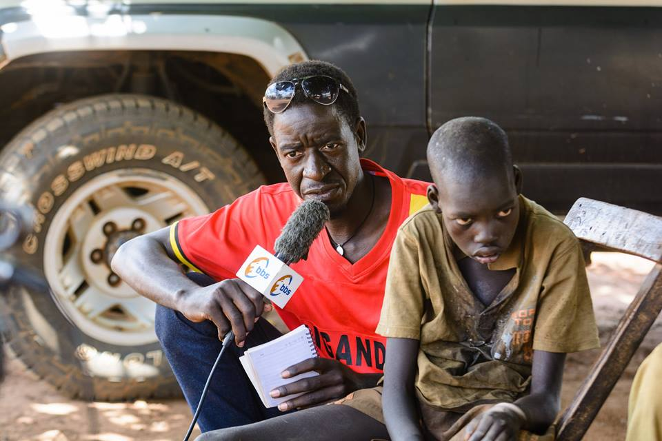 Pat Robert with Ochora walter during one of his reporting project on nodding Syndrome a neurological disease that has crippled ocer 5,000 children in Northern Uganda.