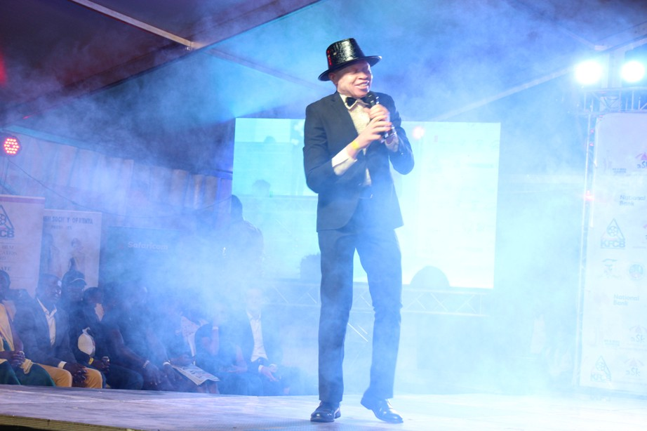 Peter Ogik, the CEO Source of the Nile Union of persons with Albinsim perform his famous song Equality before guest during the Mr and Miss Albinism East Africa at KICC Kenya.