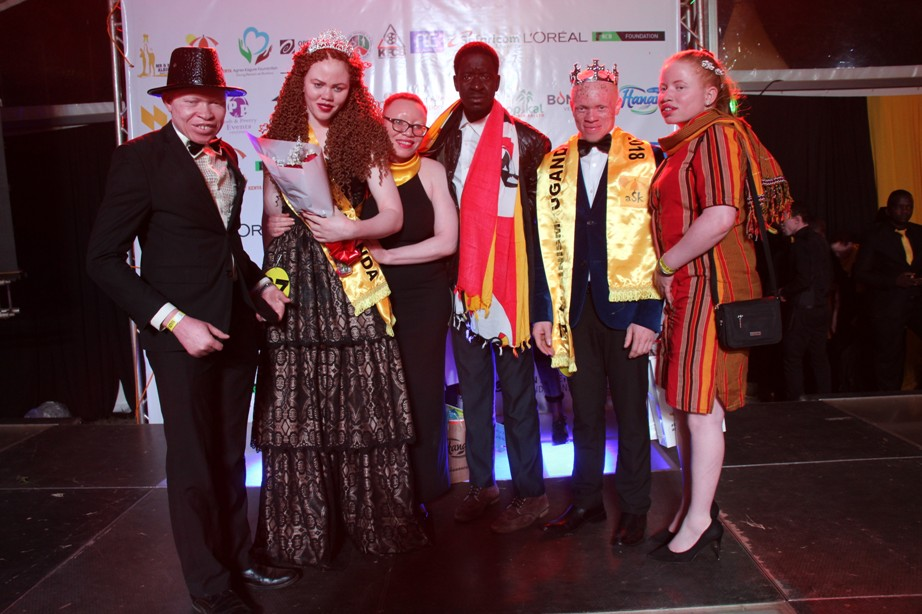 Ugandan team celebrate the win in the first ever region contest of Mr and Miss Albinism.